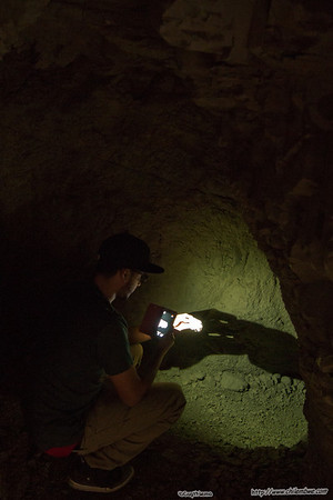 Examining rock samples inside the mud cave